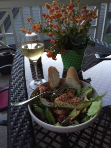 On the porch with a grilled salmon salad and Scholarship White from College Cellars.